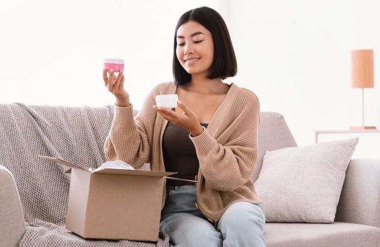 Woman opening box with skincare products