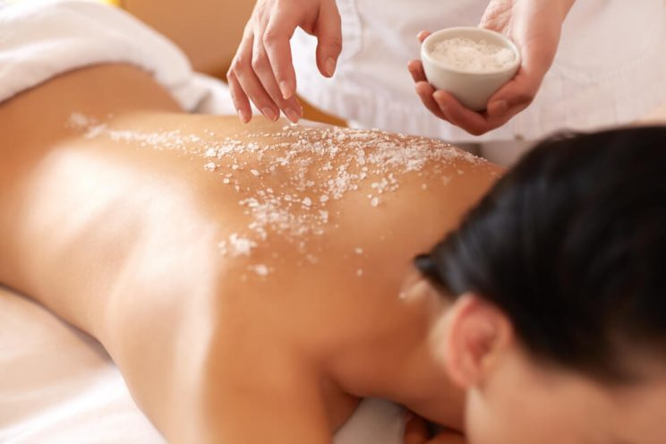 Woman with salt scrub on back