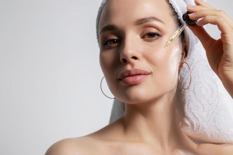 Woman applying serum