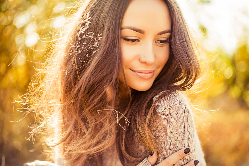 Woman in autumn - Skincare for fall